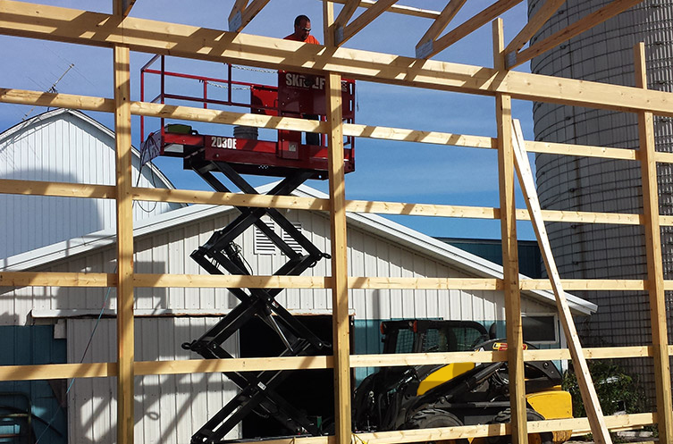 Tyler Burnside of Red River Valley Construction and Remodeling testing Skid-Lift before the first production build.