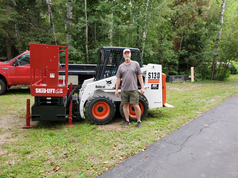 Bill with Skid-Lift on his Bobcat