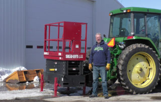 Craig Blair with Skid-Lift on Johne Deere Tractor