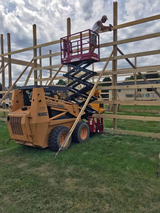 2230S Skid-Lift with Case 1845C Skidsteer on Job Site
