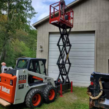 Staining a Building with the Skid-Lift